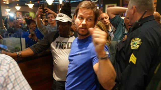 Wahlburgers opening fistbumping